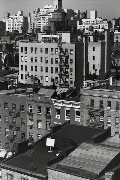 André Kertész - Untitled (cityscape with easel and blank canvas), 1977