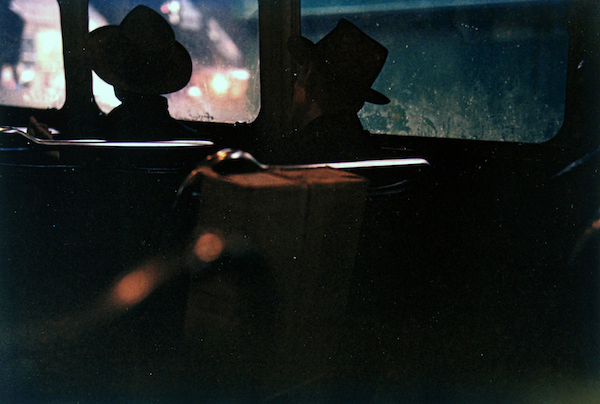 Saul Leiter - Untitled (two men in hats on train at night), 1950s