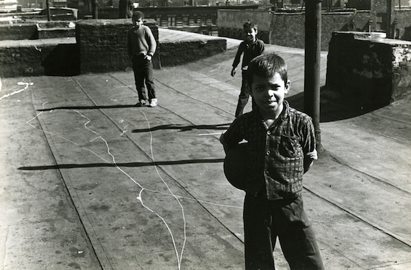 Jan Yoors - Boy with ball on rooftop, Spanish Harlem, 1963