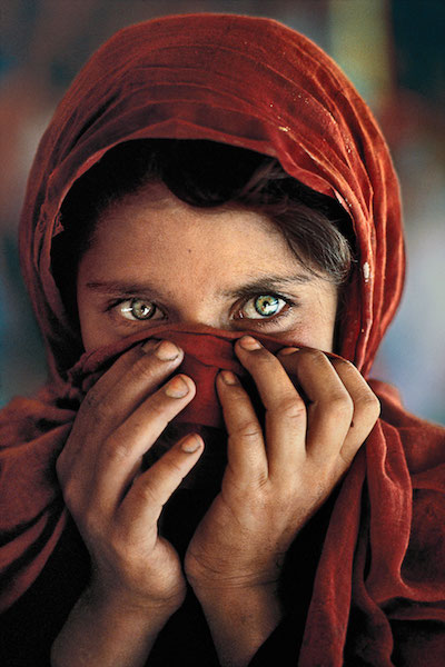 Steve McCurry - Afghan girl hiding face, 1984