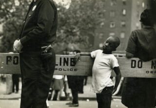 Jan Yoors - Boy at the police line, 1966